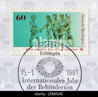 Cancelled Postage stamp printed by Germany, that shows Disabled and healthy people walking together, circa 1981.