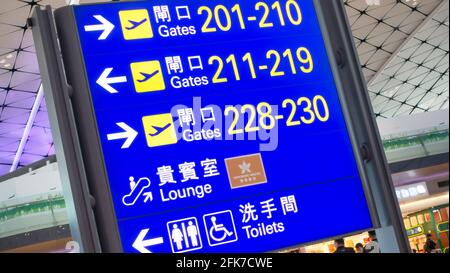 Hong Kong - Mars 20, 2018. Airport gates sign at Hong. kong Airport. Hong Kong International Airport is the Hong Kong's main airport.
