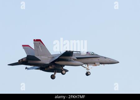 A McDonnell Douglas F/A-18c Hornet with the Marine Fighter Attack Squadron 232 (VMFA-232) known as The Red Devils flying near NAF Atsugi airbase in Ka Stock Photo