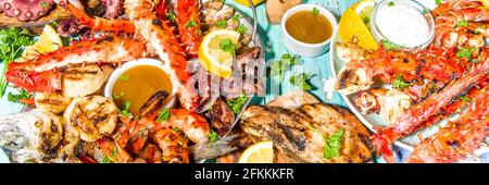 Assortment various barbecue Mediterranean grill food - fish, octopus, shrimp, crab, seafood, mussels, summer diet bbq party fest, with kebab, sauces,
