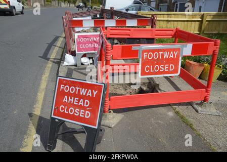 Maidstone, Kent, UK. Footway Closed signs at a caved-in pavement