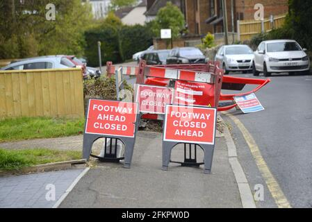 Maidstone, Kent, UK. 3 different Footpath Closed signs at a caved-in pavement