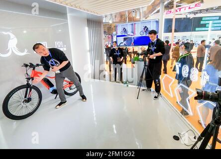 Shanghai. 5th May, 2021. A staff member introduces a bike via live streaming during the 30th China International Bicycle Fair in east China's Shanghai, May 5, 2021. The four-day event kicked off here on Wednesday, drawing more than 1,000 enterprises to participate. Credit: Li He/Xinhua/Alamy Live News