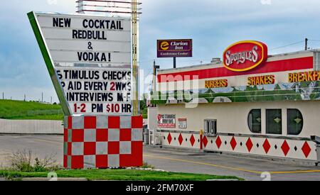 Emporia, KS, USA. 6th May, 2021. Spangles now hiring signs at location in Emporia, Kansas as businesses look to hire employees and increase normal production after the COVID-19 pandemic on May 6, 2021. Credit: Mark Reinstein/Media Punch/Alamy Live News