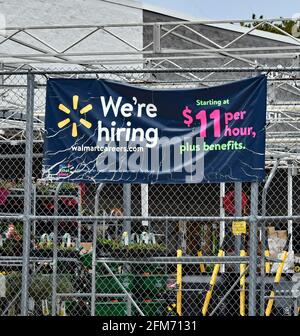 Emporia, KS, USA. 6th May, 2021. Walmart now hiring signs at location in Emporia, Kansas as businesses look to hire employees and increase normal production after the COVID-19 pandemic on May 6, 2021. Credit: Mark Reinstein/Media Punch/Alamy Live News