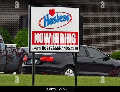 Emporia, KS, USA. 6th May, 2021. Hostess plant where Twinkies snack cakes are produced now hiring signs at location in Emporia, Kansas as businesses look to hire employees and increase normal production after the COVID-19 pandemic on May 6, 2021. Credit: Mark Reinstein/Media Punch/Alamy Live News