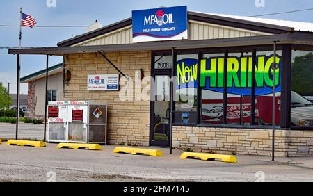 Emporia, KS, USA. 6th May, 2021. MFA OIL delivery company now hiring signs at location in Emporia, Kansas as businesses look to hire employees and increase normal production after the COVID-19 pandemic on May 6, 2021. Credit: Mark Reinstein/Media Punch/Alamy Live News