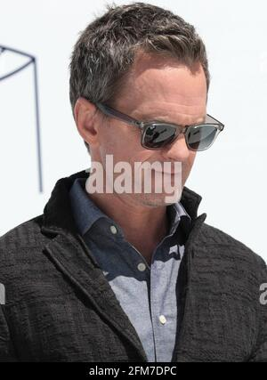 East Rutherford, NJ, USA. 6th May, 2021. Neil Patrick Harris Photo Call for CLEAR Brings Together Over 100 Family Members Separated During COVID to Reunite for the First Time, MetLife Stadium, East Rutherford, NJ May 6, 2021. Credit: CJ Rivera/Everett Collection/Alamy Live News