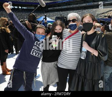 East Rutherford, NJ, USA. 6th May, 2021. Family reunion Photo Call for CLEAR Brings Together Over 100 Family Members Separated During COVID to Reunite for the First Time, MetLife Stadium, East Rutherford, NJ May 6, 2021. Credit: CJ Rivera/Everett Collection/Alamy Live News