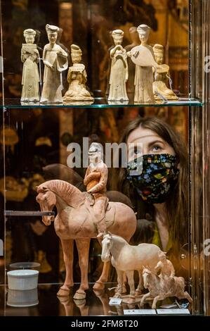 London, UK. 7th May, 2021. Lots from the Roger Keverne Ltd: Moving On sale - Preview of the Asian Art sale at Bonhams, New Bond Street, London. The sales range over several days between 10-13 May. Credit: Guy Bell/Alamy Live News Stock Photo
