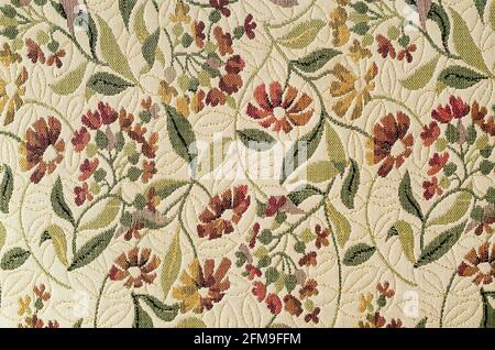 Vintage old fashioned fabric tapestry with floral ornaments