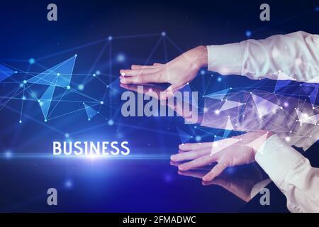 Businessman touching huge screen concept