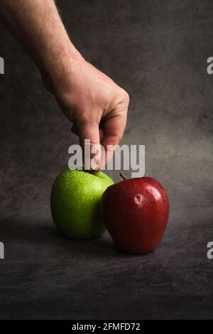 green and red apples on a dark background