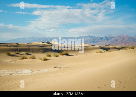 Mesquite Flat Sand Dunes, mountains, and cloudy sky, Death Valley National Park, California