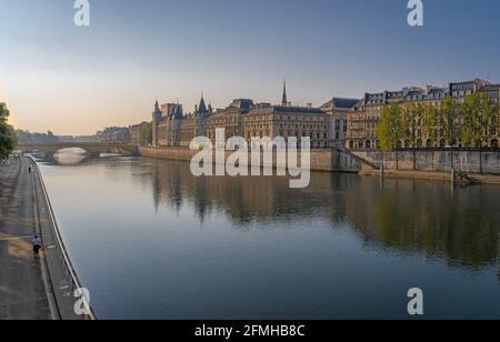 Paris, France - 05 02 2021: Panoramic view of Pont au Change and La Conciergerie on Ile de la Cité from quai de Seine