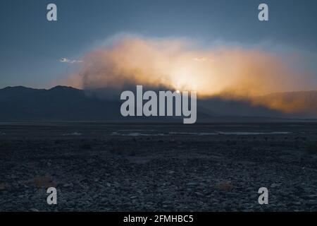 Sandstorm in desert at sunset. Dramatic landscape, Death Valley National Park, California