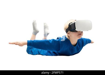 Boy flies in virtual reality glasses isolated on white background. 3d video games concept