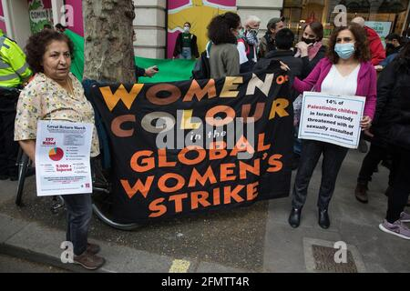 London, UK. 11th May, 2021. Activists from Women of Colour in the Global Women's Strike take part in a protest outside the UK headquarters of Elbit Systems, an Israel-based company developing technologies used for military applications including drones, precision guidance, surveillance and intruder-detection systems. The activists were protesting against the company's presence in the UK and in solidarity with the Palestinian people at a time of a significant rise in tension in Israel and the Occupied Territories following attempts at forced evictions of Palestinian families in the Sheikh Jarra