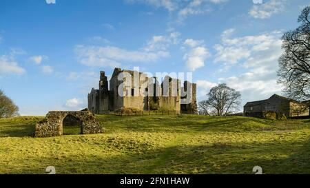 Barden Tower (sunlight on beautiful historic ancient ruin, stone arch & blue sky) - scenic rural Bolton Abbey Estate, Yorkshire Dales, England UK.