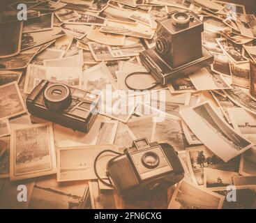 Three retro film cameras overlaid on a historic collection of time captured to a still. Archiving the forgotten