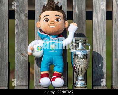 April 22, 2021 Moscow, Russia. The mascot of the UEFA European football championship Euro 2020 Skillsi and the trophy of the European championship.