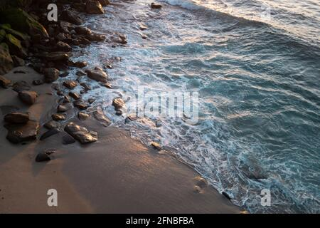 Landscape of sea and tropical beach. Sea waves and rock stones on the beach. Beautiful seascape nature. Travel and vacation, copy space.