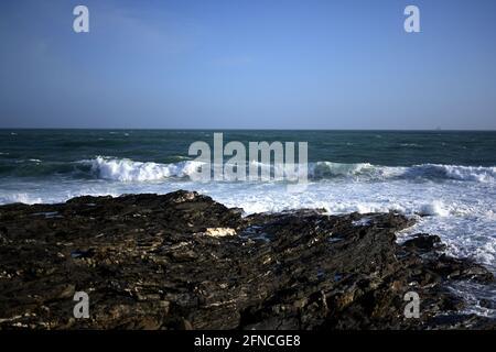 Beautiful seascape with rocky coastline and waves crashing onto the rocks, rocky and rugged coastline concept
