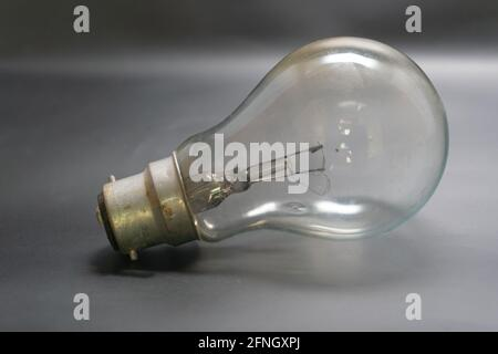 a house hold 60 watt power voltage bulb warm light produced isolated in dark black background