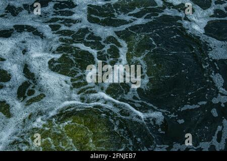 The texture of water on the surface of a small waterfall in the Ukrainian steppe close-up. Tokovsky waterfall is the only steppe waterfall in the worl