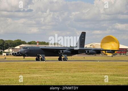 USAF Boeing B-52 Stratofortress nuclear bomber jet plane at the Royal International Air Tattoo, RIAT, at RAF Fairford, UK, trailing brake chute