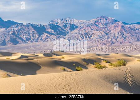 Sand dunes, mountains, and beautiful cloudy sky. Death Valley, California