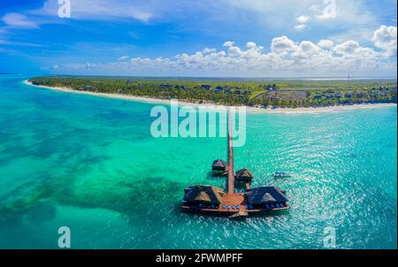 Aerial shot of the Stilt hut with palm thatch roof washed with t
