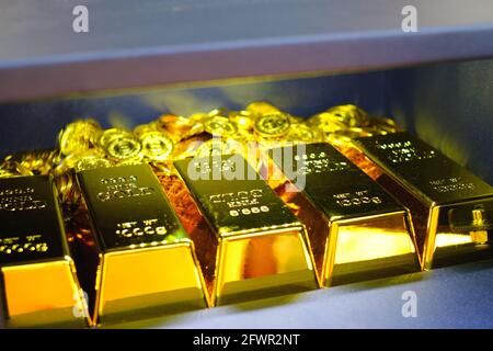 Steel safes box full of gold bar stack and coins
