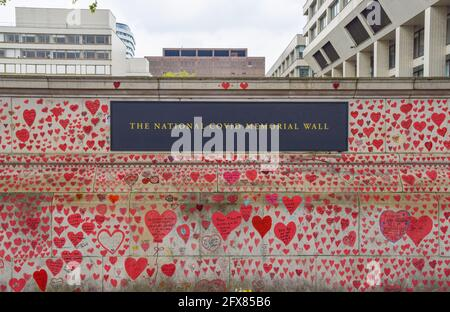 London, United Kingdom. 14th May 2021. Red hearts on the National Covid Memorial Wall outside St Thomas' Hospital. 150,000 red hearts have been painted by volunteers and members of the public, one for each life lost to Covid in the UK to date.