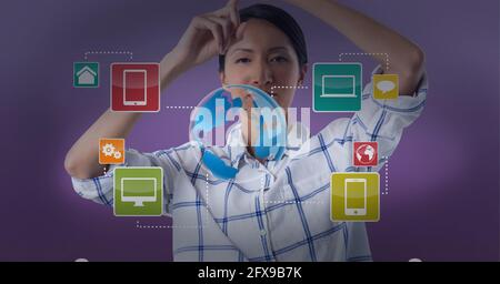 Smart devices icons and earth over a woman, technology and global connection concepts