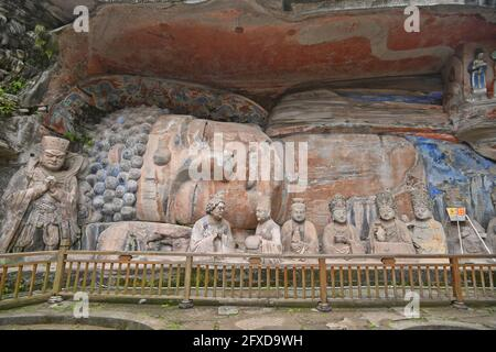 CHONGQING, CHINA - MAY 26, 2021 - Photo taken on May 26, 2021 shows the world's largest stone half-length reclining Buddha cliff statue at Dazu Stone Carvings Baoding Scenic Area in Chongqing, China. The statue is 31 meters long. The reclining Buddha, exposed to the open air for a long time, has been damaged to varying degrees and needs to be repaired urgently. (Photo by Li Dongping / Costfoto/Sipa USA)