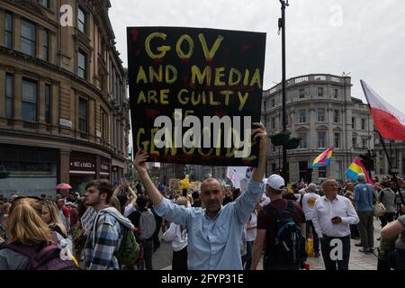 London, UK. 29th May, 2021. Thousands of demonstrators march through central London in a protest against the restrictions and legislations imposed by the Government to control the spread of coronavirus, lockdowns, mandatory face masks, vaccines and vaccine passports. Credit: Wiktor Szymanowicz/Alamy Live News
