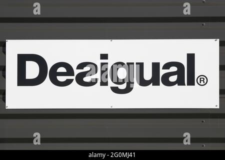 Macon, France - March 15, 2020: Desigual logo on a wall of a store. Desigual is a clothing brand headquartered in Barcelona, Catalonia, Spain