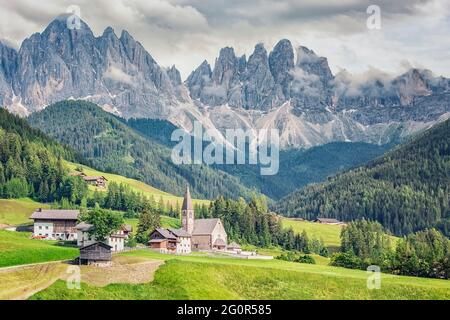 Santa Maddalena village with beautiful Dolomites mountains in the background, Val di Funes valley, Italy