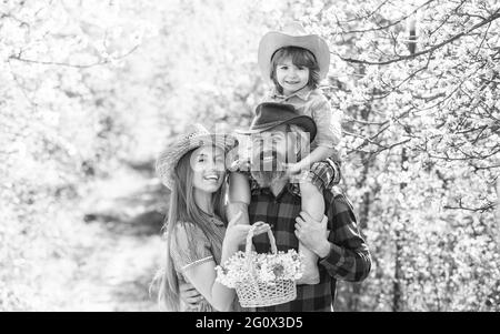 Happy family day. Mother father and cute son. Family farm. Parents growing little baby. Spend time together. Lovely family outdoors nature background