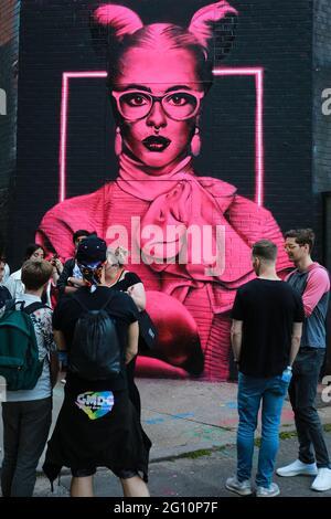 London, UK. 30 May 2021. Street Art London in Shoreditch. Neon style mural by artist David Speed. Credit: Waldemar Sikora