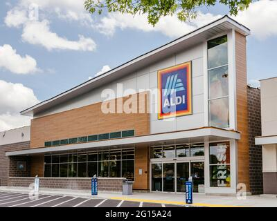 Aldi discount grocery food store front exterior with logo in Montgomery Alabama, USA.
