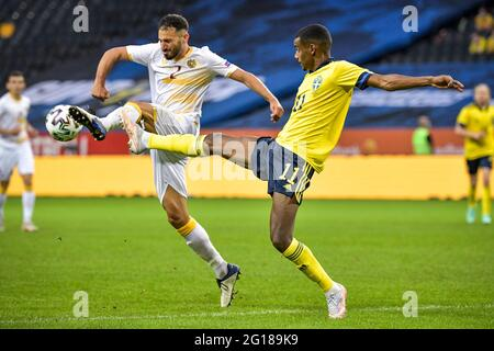 André Calisir (L) and Sweden's Alexander Isak fight for the ball during the International Friendly soccer match between Sweden and Armenia at Friends Arena in Stockholm, Sweden, on June 5, 2021. Photo: Janerik Henriksson / TT / code 10010  *** SWEDEN OUT ***