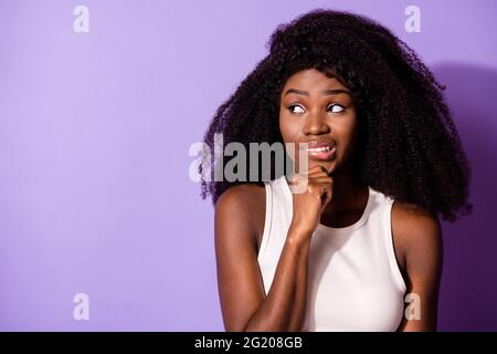 Portrait of attractive worried girl creating solution copy space overthinking isolated over bright violet purple color background
