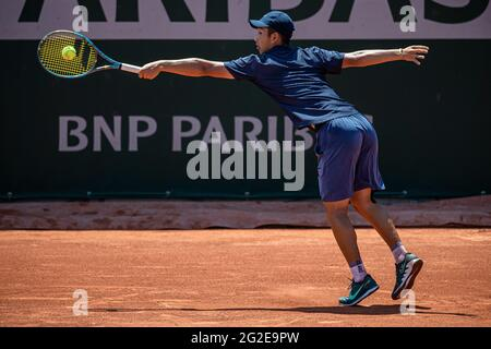 Paris, France. 10th June, 2021. Shang Juncheng of China returns the ball during the boys' singles quarterfinal match between Shang Juncheng of China and Sean Cuenin of France at the French Open tennis tournament at Roland Garros in Paris, France, June 10, 2021. Credit: Aurelien Morissard/Xinhua/Alamy Live News