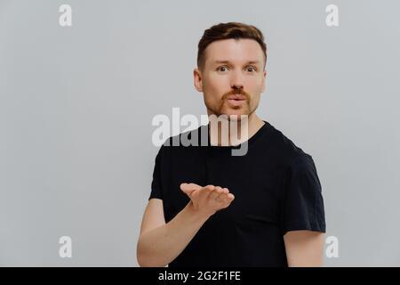 Handsome guy sending air kiss and looking at camera