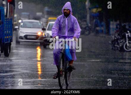 Kolkata, West Bengal, India. 11th June, 2021. A man rides a bicycle as the heavy rainfall lashes Kolkata, India. Credit: Indranil Aditya/ZUMA Wire/Alamy Live News