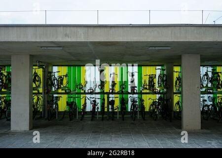 Bicycle racks at Munich Allach S-Bahn station. The colourful back walls border the station, Oertelplatz in front.