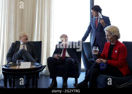 Carbis Bay, UK. 13th June, 2021. (From left to right) British Prime Minister Boris Johnson, Australian Prime Minister Scott Morrison, Canadian Prime Minister Justin Trudeau, and President of the European Commission Ursula von der Leyen, during a break in meetings at the Carbis Bay Hotel on June 12, 2021, during the G7 Summit in Cornwall, United Kingdom. Photo by Andrew Parsons/No 10 Downing Street/UPI Credit: UPI/Alamy Live News