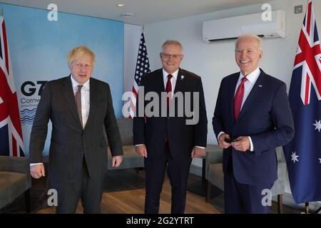Carbis Bay, UK. 13th June, 2021. (From left to right) British Prime Minister Boris Johnson, Australian Prime Minister Scott Morrison, and U.S. President Joe Biden pose for a photo at the Carbis Bay Hotel on June 12, 2021, during the G7 Summit in Cornwall, United Kingdom. Photo by Andrew Parsons/No 10 Downing Street/UPI Credit: UPI/Alamy Live News